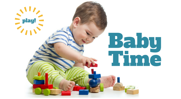Baby Time program, baby playing with blocks